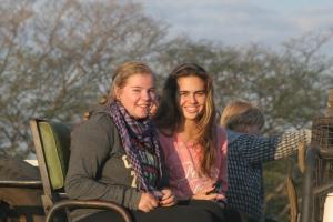 Savanna and Nicola on safari on sunset rock