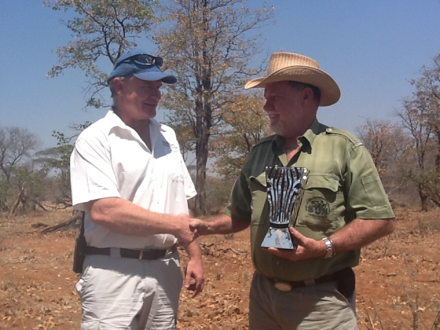 Mark Saunders of Malilangwe meets Clive under a Mopani Tree