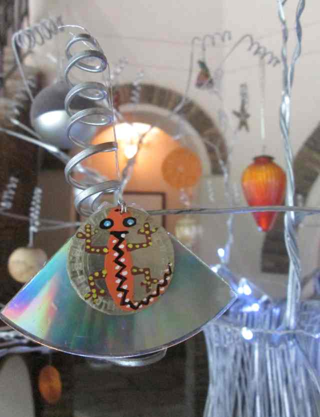 hand painted bottle top and cd disc decoration