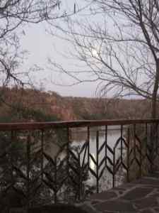full moon setting through the rails