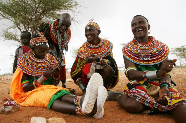 Samburu artisans working and sharing a gossip in Sera Conservancy, Northern Kenya. (Photograph by Erin Moroney)
