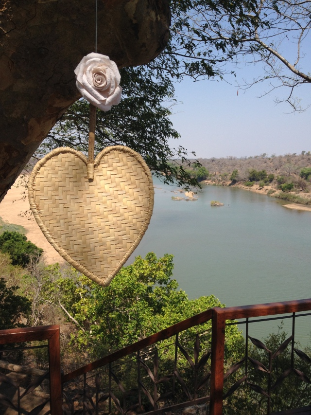 heart fans hanging from the wedding deck at Chilo